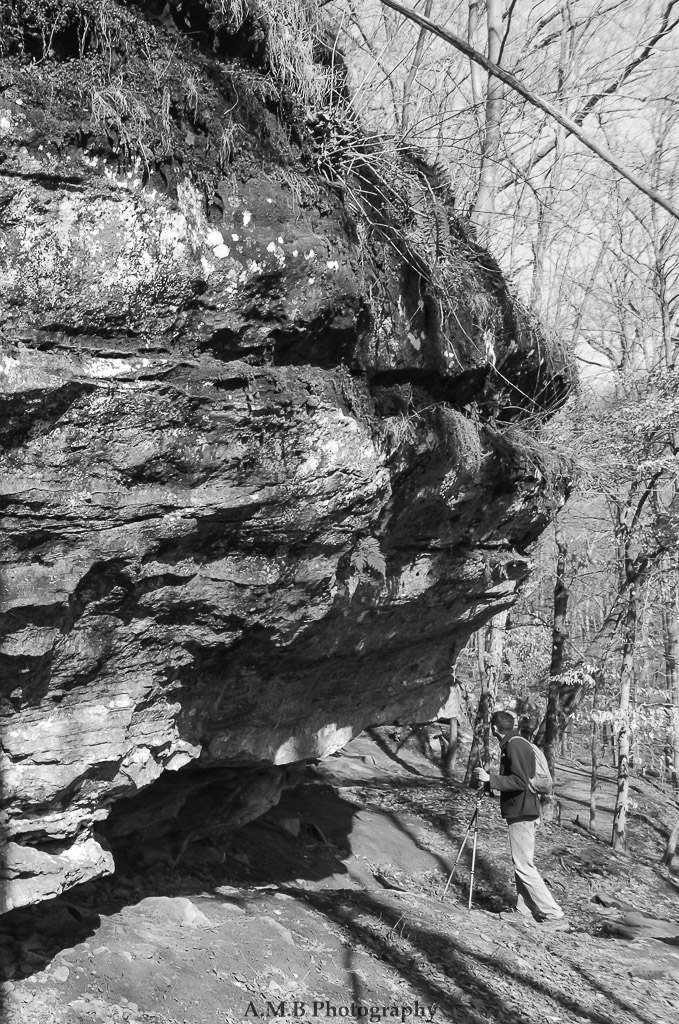 "My husband, who is 6'4"", standing underneath the cliffsides in a Southern Illinois State Park. One of my favorites. ;)"